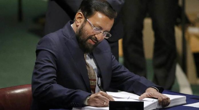Indian Union Minister of State for Environment, Forests and Climate Change Prakash Javadekar signs the Agreement