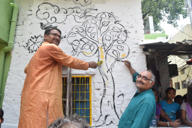 ABID members are painting the wall at the inaugural of The Makeover Story to mark the occassion of pre-independence day celebration