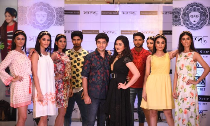 Gaurav Chakrabarty and Riddhima Ghosh pose with models at the Western Wear Fashion Show at Shoppers Stop Sananda Pujor Bazar 2016