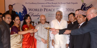 "Governor of West Bengal Keshari Nath Tripathi (C) with Consulates in Kolkata USA, China, Germany, Nepal & others also lighting ""Peace Lamp"" during ""World Peace Day"""