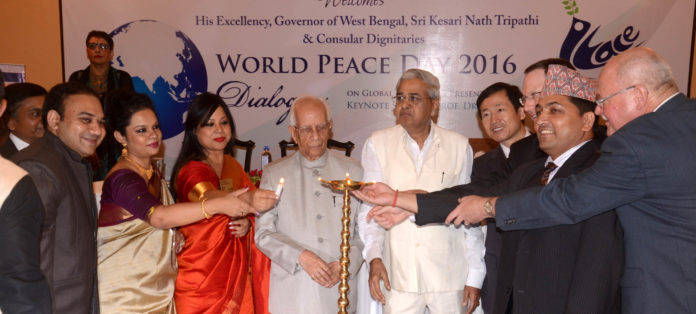 Governor of West Bengal Keshari Nath Tripathi (C) with Consulates in Kolkata USA, China, Germany, Nepal & others also lighting