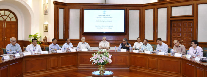 Narendra Modi chairing the meeting to review steps towards holistic development of islands