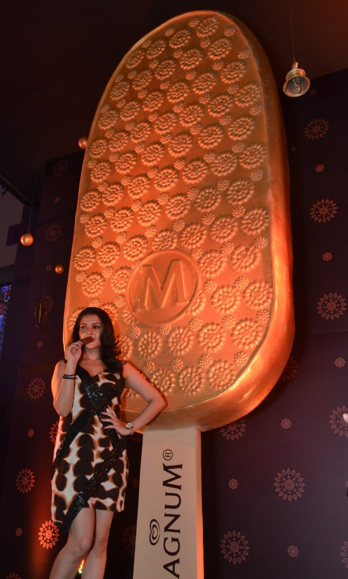 Payel in front of the installation