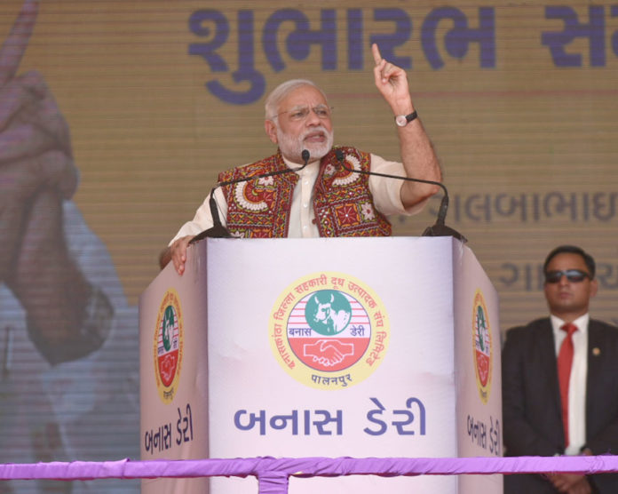 The Prime Minister, Shri Narendra Modi addressing at the inauguration of the Amul Cheese Plant and Whey Drying Plant, in Palanpur, Banaskantha, Gujarat on December 10, 2016.