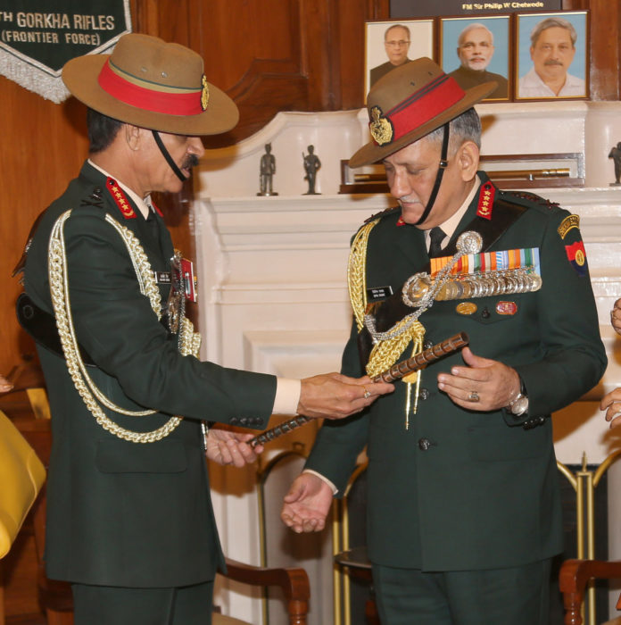 General Dalbir Singh handing over the baton to General Bipin Rawat in the office of Chief of Army Staff, in New Delhi on December 31, 2016.