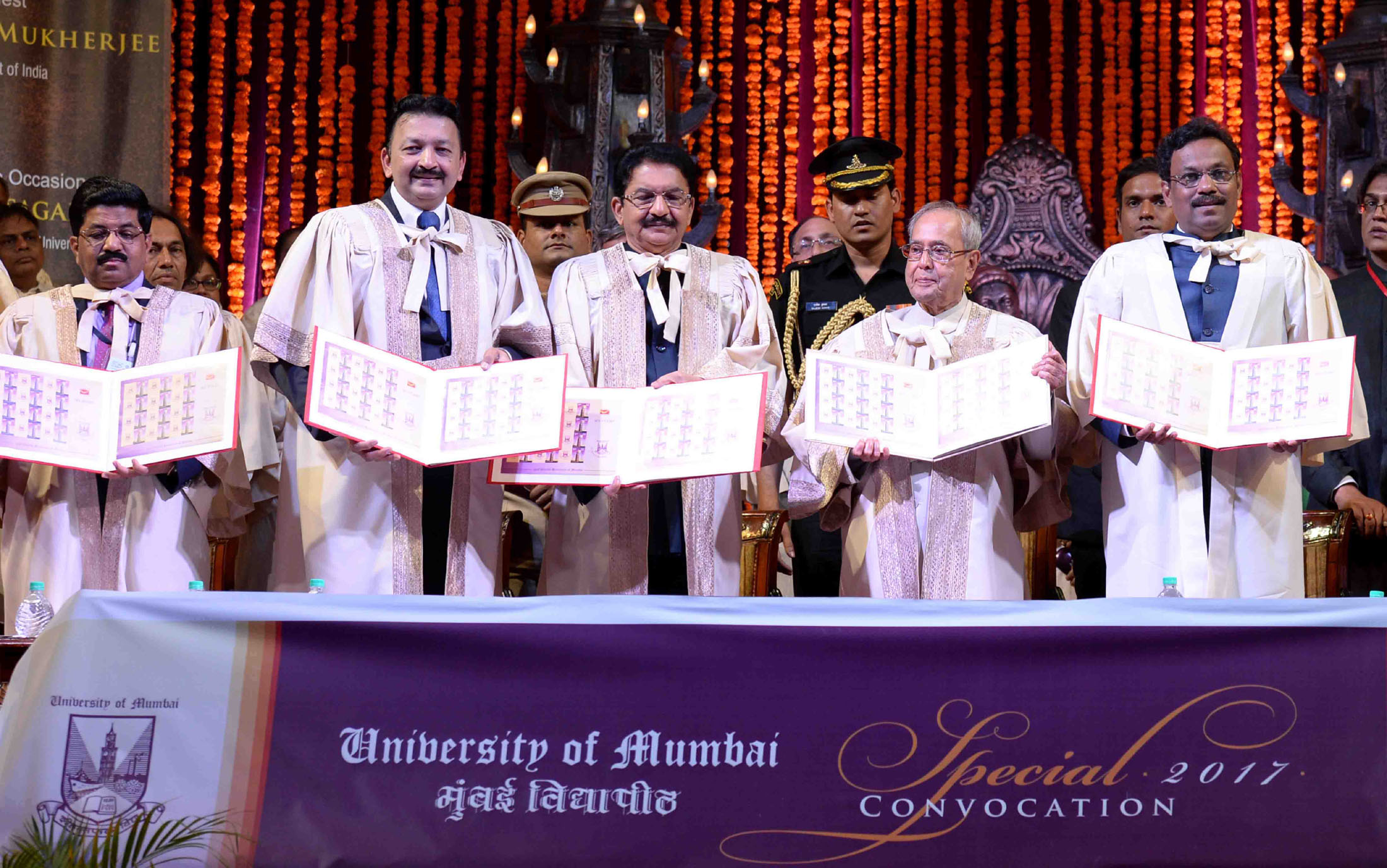 The President, Shri Pranab Mukherjee releasing the postal stamp at the special convocation of University of Mumbai, in Mumbai on March 17, 2017. The Governor of Maharashtra, Shri C. Vidyasagar Rao and other dignitaries are also seen.