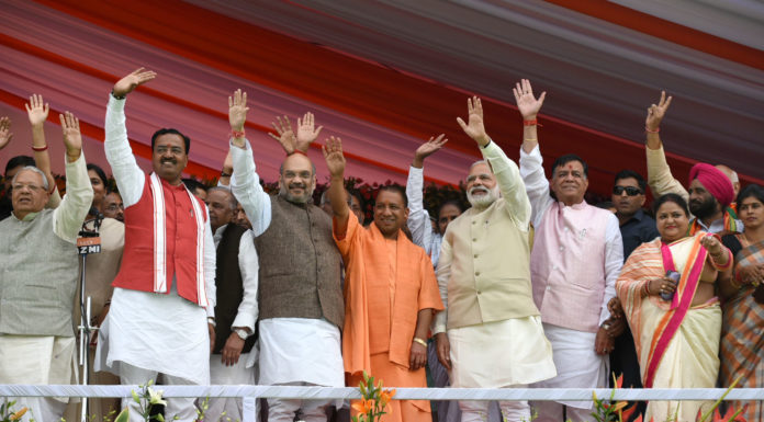 The Prime Minister, Shri Narendra Modi at the swearing-in ceremony of the new government of Uttar Pradesh, at Lucknow on March 19, 2017. The Union Minister for Micro, Small and Medium Enterprises, Shri Kalraj Mishra, the Chief Minister of Uttar Pradesh, Yogi Adityanath and other dignitaries are also seen.