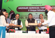 """The Union Minister for Electronics & Information Technology and Law & Justice, Shri Ravi Shankar Prasad presenting the award for outstanding performance, at the inauguration of the workshop on """"Aadhaar Services - A Unique Initiative through CSC"""", in New Delhi on July 11, 2017. The Secretary, Ministry of Electronics & Information Technology, Shri Ajay Prakash Sawhney, the Director General and Mission Director, UIDAI, Dr. Ajay Bhushan Pandey and other dignitaries are also seen."""