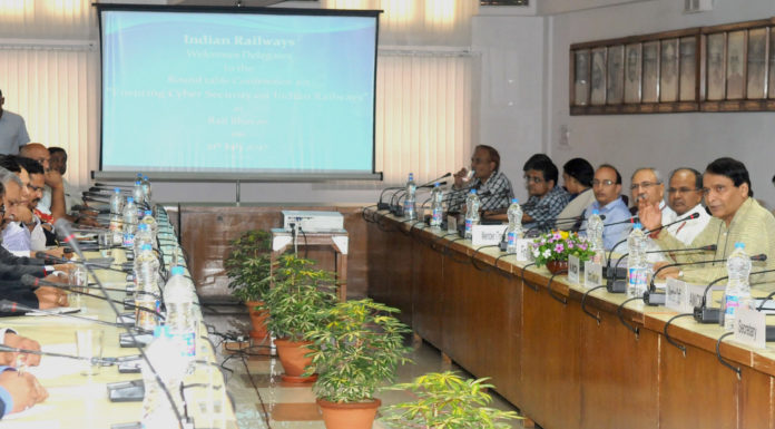 """The Union Minister for Railways, Shri Suresh Prabhakar Prabhu addressing the Round Table Conference on """"Ensuring Cyber Security on Indian Railways"""", in New Delhi on July 21, 2017. The Chairman, Railway Board, Shri A.K. Mital and other dignitaries are also seen."""