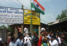 Siddiqullah Chowdhury hosting National Flag at Mongolkote Constituency