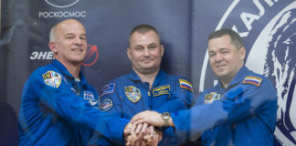 Expedition 47 prime crew members: Flight Engineer Jeff Williams of NASA, left; Soyuz Commander Alexey Ovchinin of Roscosmos, center; and Flight Engineer Oleg Skripochka of Roscosmos, right; pose for a photo at the conclusion of a press conference on Thursday, March 17, 2016, at the Cosmonaut Hotel in Baikonur, Kazakhstan. Launch of the Soyuz rocket is scheduled for March 19 Baikonur time and will carry Skripochka, Ovchinin, and Williams into orbit to begin their five and a half month mission on the International Space Station.