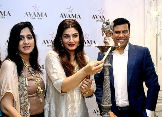 L-R - Mrs. Suman Kajaria, Actress Raveena Tandon & Mr. Abhishek kajaria were lightening the lamp