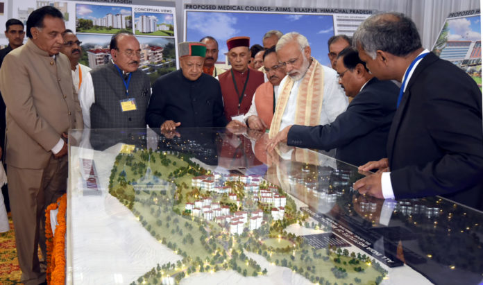 The Prime Minister, Shri Narendra Modi being briefed on structure of AIIMS, in Bilaspur, Himachal Pradesh on October 03, 2017. The Union Minister for Health & Family Welfare, Shri J.P. Nadda, the Chief Minister of Himachal Pradesh, Shri Virbhadra Singh and other dignitaries are also seen.