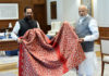 The Prime Minister, Shri Narendra Modi hands over Chaadar to be offered at Dargah Khwaja Moinuddin Chishti Ajmer Sharif to the Union Minister for Minority Affairs, Shri Mukhtar Abbas Naqvi, in New Delhi on March 17, 2018.