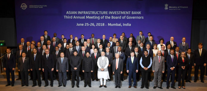 The Prime Minister, Shri Narendra Modi in a group photograph at the Third Annual Meeting of the Asian Infrastructure Investment Bank (AIIB), in Mumbai on June 26, 2018. The Governor of Maharashtra, Shri C. Vidyasagar Rao, the Union Minister for Railways, Coal, Finance and Corporate Affairs, Shri Piyush Goyal, the Chief Minister of Maharashtra, Shri Devendra Fadnavis and other dignitaries are also seen.
