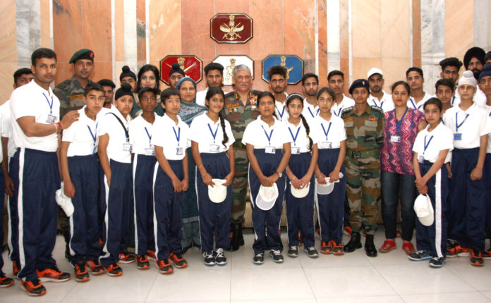 The Chief of Army Staff, General Bipin Rawat with the students and teachers from Jammu & Kashmir, in New Delhi on June 29, 2018.
