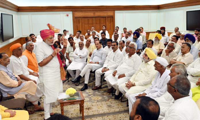 The Prime Minister, Shri Narendra Modi interacting with a group of sugarcane farmers, at Lok Kalyan Marg, in New Delhi on June 29, 2018. The Union Minister for Agriculture and Farmers Welfare, Shri Radha Mohan Singh is also seen.