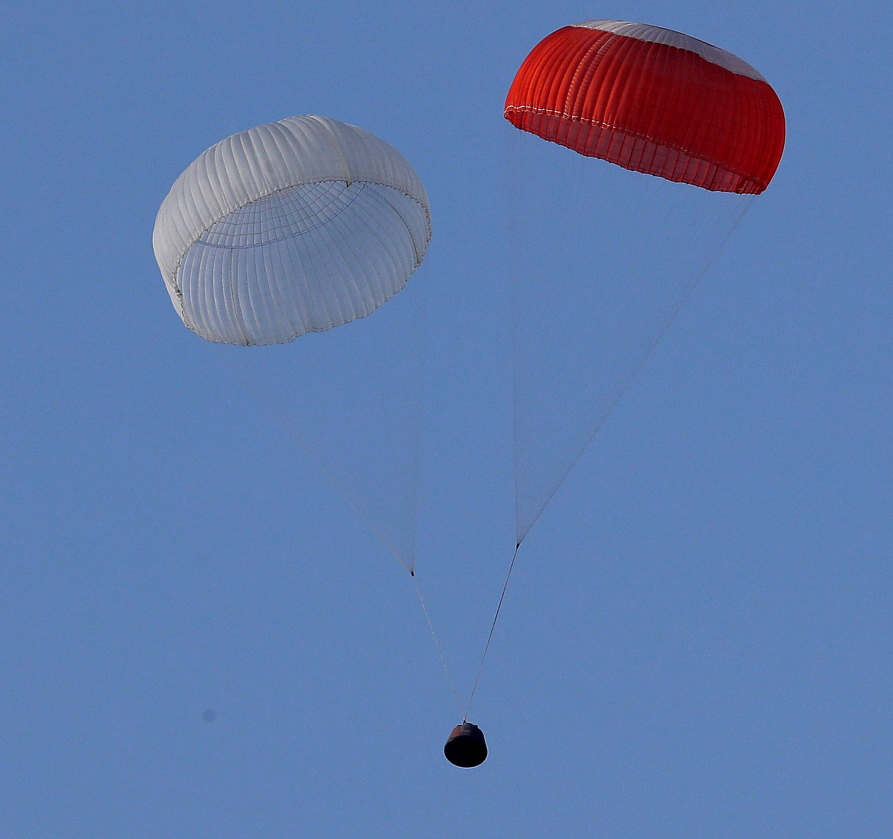 The Crew Module, part the Crew Escape System (CES), floating back to earth under its parachutes over the Bay of Bengal about 2.9 km from the  Satish Dhawan Space Centre, Sriharikota, during a test conducted by the Indian Space Research Organisation (ISRO), in Andhra Pradesh on July 05, 2018.