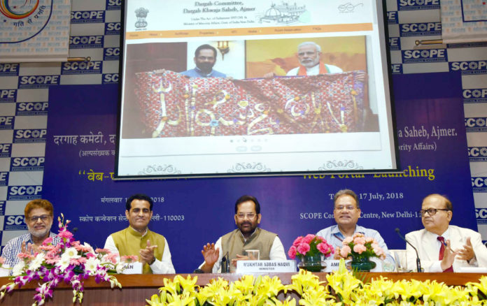 The Union Minister for Minority Affairs, Shri Mukhtar Abbas Naqvi launching the Web-Portal of Dargah Khwaja Saheb, Ajmer, at a function, in New Delhi on July 17, 2018. The Secretary, Ministry of Minority Affairs, Shri Ameising Luikham and other dignitaries are also seen.