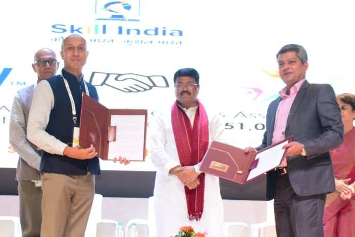 Rajat Banerjee Vice President Corporate Affiars Amway India Jaames A Raphael Execuitive Head RASCI signing the MOU in presence of Dharmendra Pradhan Hon'ble minis