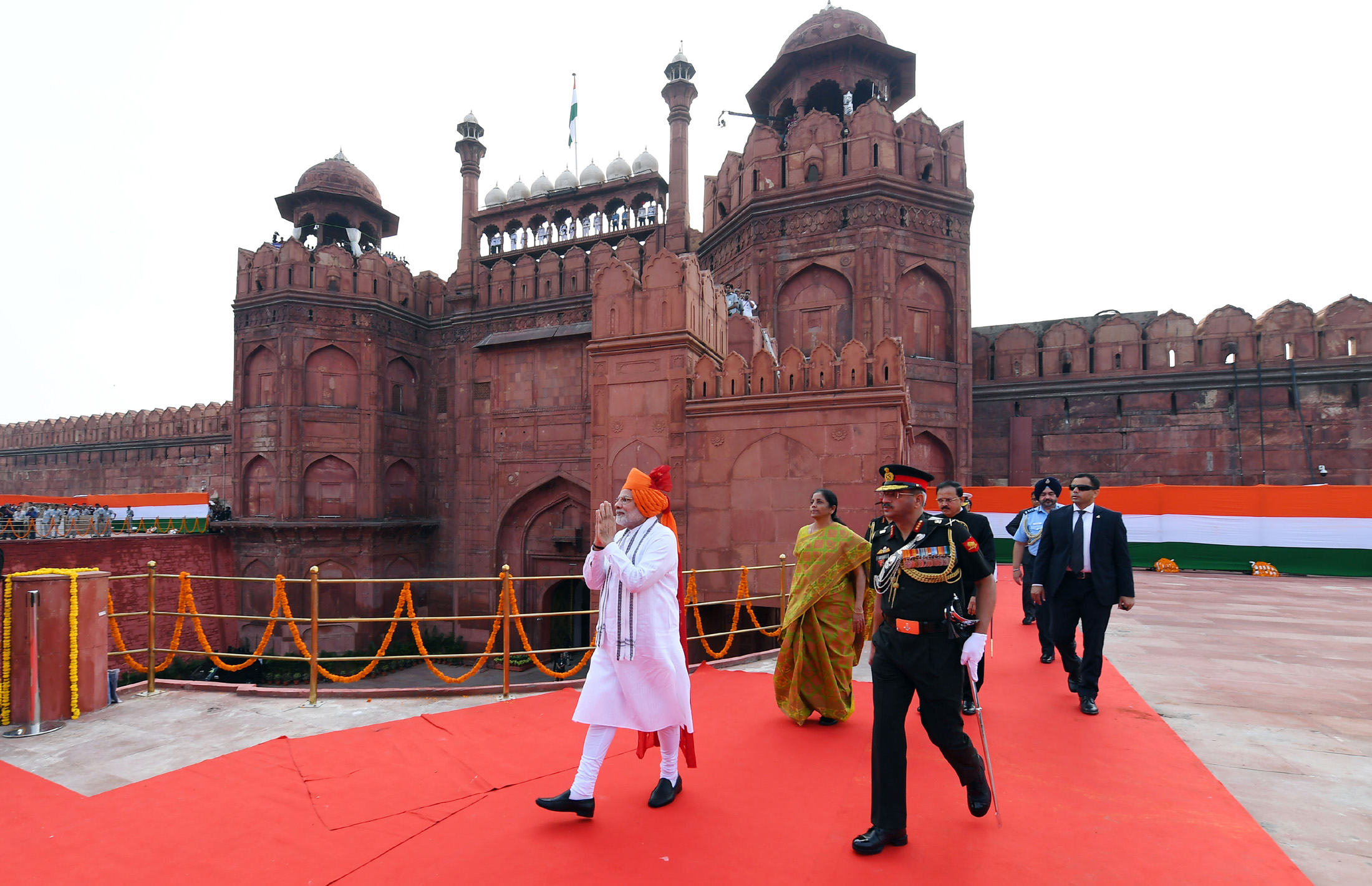 The Prime Minister, Shri Narendra Modi walking towards the dais to address the Nation at the Red Fort, on the occasion of 72nd Independence Day, in Delhi on August 15, 2018. The Union Minister for Defence, Smt. Nirmala Sitharaman and the Minister of State for Defence, Dr. Subhash Ramrao Bhamre are also seen.