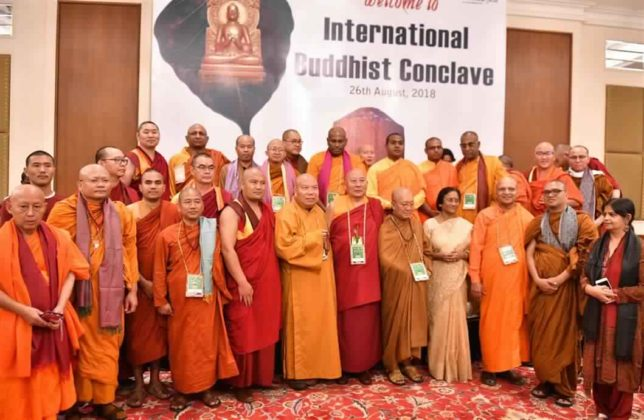 The Minister of Tourism, Uttar Pradesh, Prof. Rita Bahuguna Joshi with the delegates of the International Buddhist Conclave - 2018, at Varanasi, in Uttar Pradesh on August 26, 2018.
