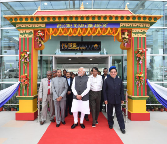 The Prime Minister, Shri Narendra Modi at the inauguration of the Pakyong Airport, in Gangtok, Sikkim on September 24, 2018. The Governor of Sikkim, Shri Ganga Prasad, the Union Minister for Commerce & Industry and Civil Aviation, Shri Suresh Prabhakar Prabhu, the Chief Minister of Sikkim, Shri Pawan Kumar Chamling and the Minister of State for Development of North Eastern Region (I/C), Prime Minister's Office, Personnel, Public Grievances & Pensions, Atomic Energy and Space, Dr. Jitendra Singh are also seen.