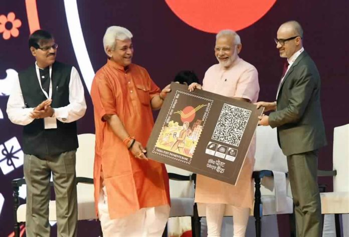 The Prime Minister, Shri Narendra Modi at the launch of the India Post Payments Bank, in New Delhi on September 01, 2018. The Minister of State for Communications (I/C) and Railways, Shri Manoj Sinha and the Secretary (Post), Shri Ananta Narayan Nanda are also seen.