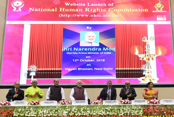 The Prime Minister, Shri Narendra Modi at the Silver Jubilee Foundation Day function of the National Human Rights Commission, in New Delhi on October 12, 2018. The Union Home Minister, Shri Rajnath Singh, the Minister of State for Communications (I/C) and Railways, Shri Manoj Sinha and other dignitaries are also seen.