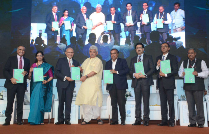 The Minister of State for Communications (I/C) and Railways, Shri Manoj Sinha releasing the publication, at the inauguration of the India Mobile Congress - 2018, in New Delhi on October 25, 2018. The Secretary, (Telecom), Ms. Aruna Sundararajan and other dignitaries are also seen.