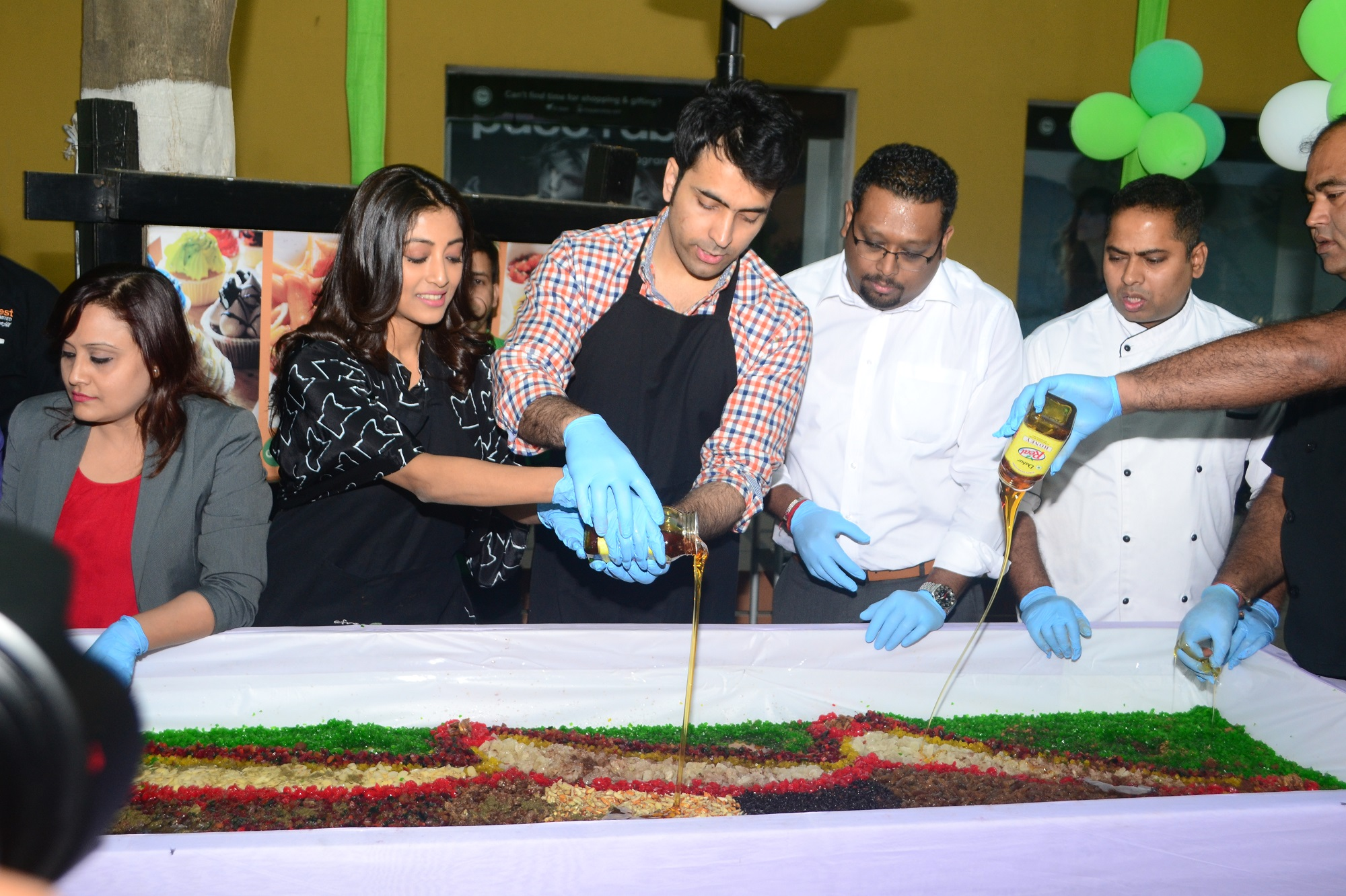 Abir Chatterjee and Paoli Dam and Mayukh Ray ,President Sales and Marketing at Cake Mixing Ceremony at Afraa Deli, City Centre 1