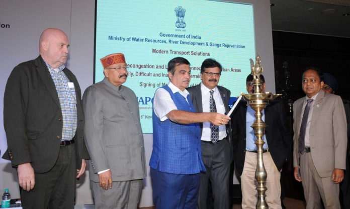 The Union Minister for Road Transport & Highways, Shipping and Water Resources, River Development & Ganga Rejuvenation, Shri Nitin Gadkari lighting the lamp at the signing ceremony of an MoU between WAPCOs and M/s Doppelmayr, Austria for Modern Transport Solutions for Decongestion and Last Mile Connectivity in Urban Areas and Hilly, Difficult & Inaccessible Terrains, in New Delhi on November 05, 2018.