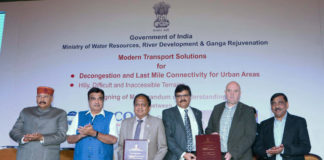 The Union Minister for Road Transport & Highways, Shipping and Water Resources, River Development & Ganga Rejuvenation, Shri Nitin Gadkari witnessing the signing ceremony of an MoU between WAPCOs and M/s Doppelmayr, Austria for Modern Transport Solutions for Decongestion and Last Mile Connectivity in Urban Areas and Hilly, Difficult & Inaccessible Terrains, in New Delhi on November 05, 2018. The Secretary, Water Resources, River Development and Ganga Rejuvenation, Shri U.P. Singh and other dignitaries are also seen.