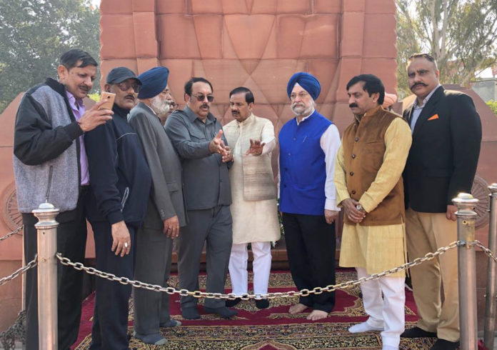 """The Minister of State for Culture (I/C) and Environment, Forest & Climate Change, Dr. Mahesh Sharma along with the Minister of State for Housing and Urban Affairs (I/C), Shri Hardeep Singh Puri inspecting the site at Jallianwala Bagh as the Govt. prepares to observe the remembrance of """"100 years of Jallianwala Bagh Massacre"""" in 2019, in Amritsar, Punjab on November 23, 2018."""