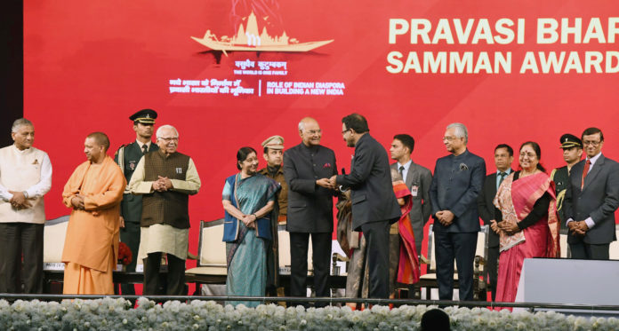 The President, Shri Ram Nath Kovind presenting the Pravasi Bharatiya Samman Awards, at the closing session of the 15th Pravasi Bharatiya Divas Convention 2019, in Varanasi, Uttar Pradesh on January 23, 2019. The Prime Minister of Mauritius, Mr. Pravind Jugnauth, the Governor of Uttar Pradesh, Shri Ram Naik, the Union Minister for External Affairs, Smt. Sushma Swaraj, the Chief Minister of Uttar Pradesh, Yogi Adityanath, the Minister of State for External Affairs, General (Retd.) V.K. Singh and other dignitaries are also seen.