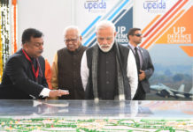 The Prime Minister, Shri Narendra Modi at the inauguration and foundation stone laying ceremony of various development projects, in Jhansi, Uttar Pradesh on February 15, 2019. The Governor of Uttar Pradesh, Shri Ram Naik is also seen.