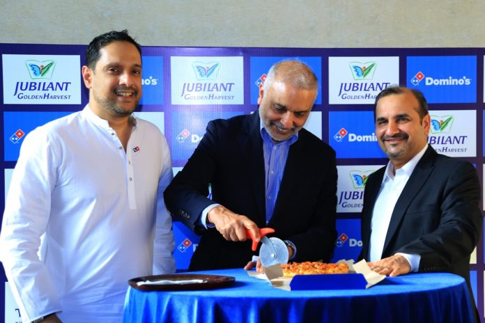 . Hari S. Bhartia, Co-Chairman, Jubilant FoodWorks Limited, Mr. Pratik Pota, CEO & Whole-time Director, Jubilant FoodWorks Limited and Mr. Rajeeb Samdani, Managing Director, Golden Harvest Group launch first Domino's Pizza restaurant in Dhaka, Bangladesh