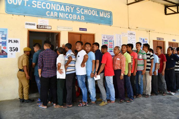 The voters standing in the queues to cast their votes, at a polling booth, during the 1st Phase of General Elections-2019, in Car Nicobar, Andaman and Nicobar Islands on April 11, 2019.