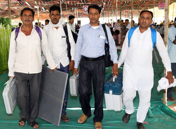 Polling officials carrying the Electronic Voting Machine (EVMs) and other necessary inputs required for the General Elections-2019, at the distribution centre, at Jodhpur, Rajasthan on April 28, 2019.