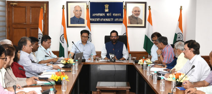 The Union Minister for Minority Affairs, Shri Mukhtar Abbas Naqvi chairing a meeting, in New Delhi on June 04, 2019. The Minister of State for Youth Affairs & Sports (Independent Charge) and Minority Affairs, Shri Kiren Rijiju is also seen.