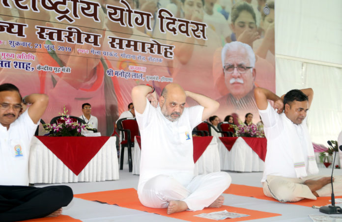 The Union Home Minister, Shri Amit Shah performing Yoga, on the occasion of the 5th International Day of Yoga 2019, at Rohtak, Haryana on June 21, 2019.