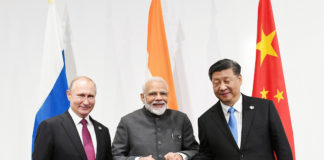 The Prime Minister, Shri Narendra Modi at the informal meeting between Russia, India and China (RIC), on the sidelines of the G-20 Summit, in Osaka, Japan on June 28, 2019.