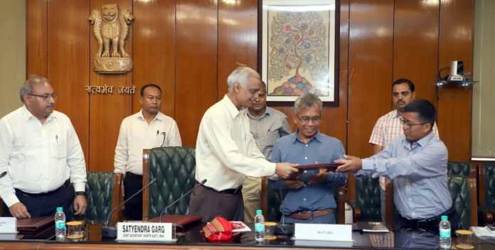 The Joint Secretary (NE) MHA, Shri Styendra Garg exchanging the files with the National Liberatin Front of Twipra (SD) representatives after Signing the Memorandum of settlement, in New Delhi on August 10, 2019.