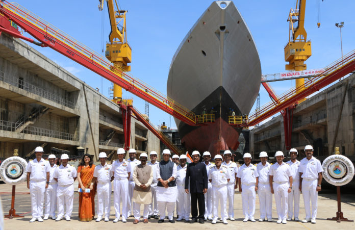 The Union Minister for Defence, Shri Rajnath Singh in a group photograph with the officials of Indian Navy, at Naval Dockyard, in Mumbai on September 28, 2019. The Minister of State for AYUSH (Independent Charge) and Defence, Shri Shripad Yesso Naik and the Chief of Naval Staff, Admiral Karambir Singh are also seen.