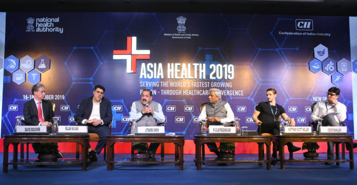 The Minister of State for Development of North Eastern Region (I/C), Prime Minister's Office, Personnel, Public Grievances & Pensions, Atomic Energy and Space, Dr. Jitendra Singh addressing the Asia Health-2019 conference, in New Delhi on October 17, 2019. The Principal Scientific Adviser to the Government of India, Prof. K. Vijay Raghavan and other dignitaries are also seen.