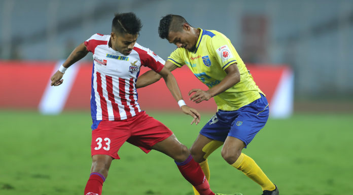 ATK's Prabir Das and KBFC's Halicharan Narzary vie for the ball in their Hero ISL clash today