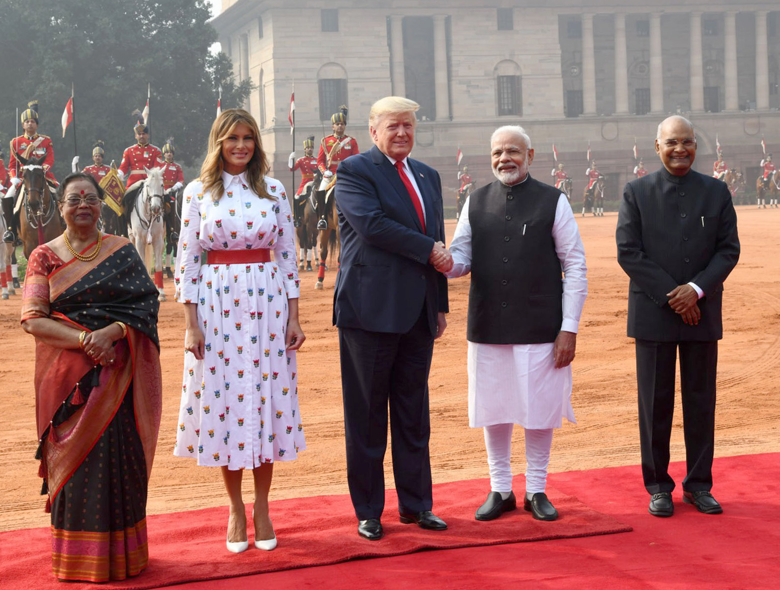 The President of United States of America (USA), Mr. Donald Trump and First Lady Mrs. Melania Trump plant a tree sapling at the Samadhi of Mahatma Gandhi, at Rajghat, in Delhi on February 25, 2020. The Minister of State for Housing & Urban Affairs, Civil Aviation (Independent Charge) and Commerce & Industry, Shri Hardeep Singh Puri is also seen.