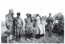 Inspecting field exercises during summer of 1942 at Konigsbruck. Major Krappe is on the extreme left, with Colonel Yamamoto next to him, in the middle is Netaji. Second from the right is Legion Adjutant Lieutenant Dr. Hans Kutscher.