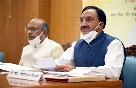 The Union Education Minister, Dr. Ramesh Pokhriyal 'Nishank' virtually addressing at the presentation of the National Award to Teachers 2020, on the occasion of Teachers' Day, in New Delhi on September 05, 2020. The Minister of State for Education, Communications and Information Technology, Shri Dhotre Sanjay Shamrao is also seen.