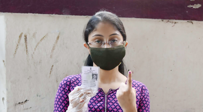A female voter showing mark of indelible ink after casting her vote, at a polling booth, during the fourth phase of the West Bengal Assembly Election, in Santoshpur, Kolkata, West Bengal on April 10, 2021.